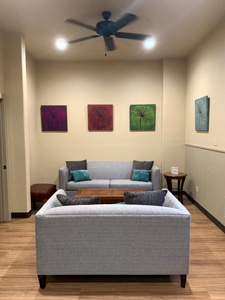 Living Room at Pin Suites with a couch and art